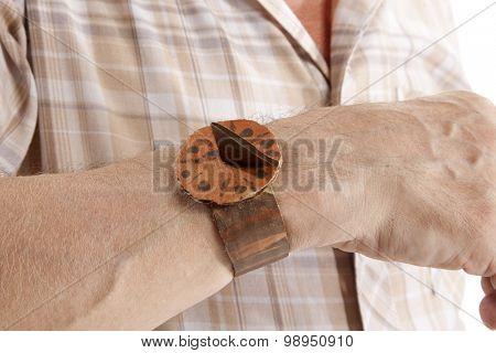 Life concept. Elderly man looks at the sundial