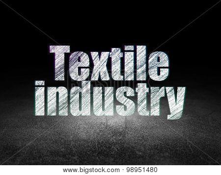 Industry concept: Textile Industry in grunge dark room