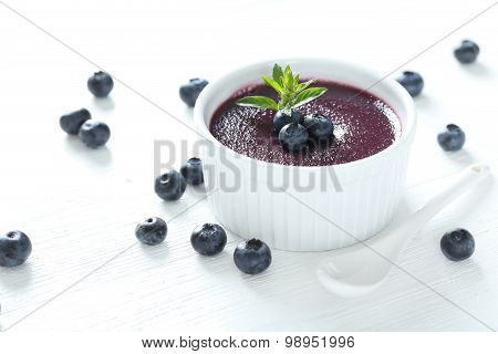 Delicious Blueberry Mousse In Bowl On Wooden Table