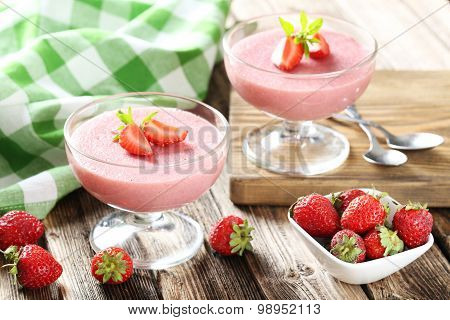 Tasty Strawberry Mousse In Glass On Brown Wooden Table