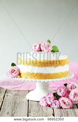 Sweet Cake On Cake Stand On Grey Wooden Background