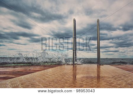 Ocean Pier On Stormy Day