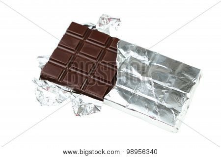 Dark Chocolate Bar In Foil Isolated On White