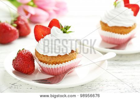Tasty Cupcake With Fresh Strawberry On White Wooden Background