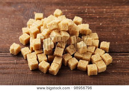 Brown Sugar On Brown Wooden Background