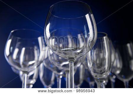 Empty wine glasses on blue background