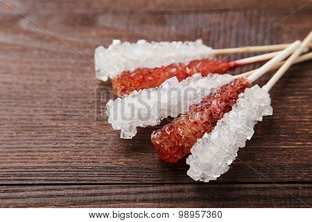 Crystal Brown And White Sugar Candy On Brown Wooden Background