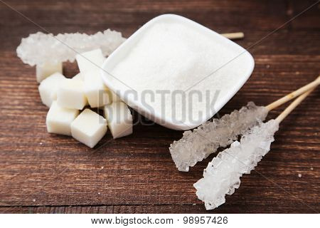 White Sugar In Bowl On Brown Wooden Background