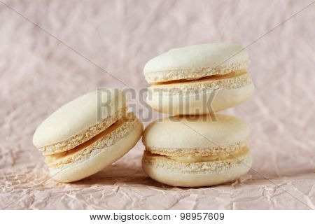 Beige Macarons On Paper Background