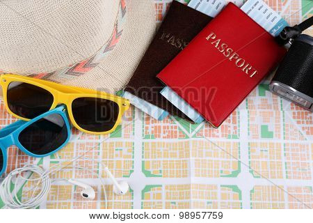 Sunglasses, passport and map, close up. Preparing for travel concept