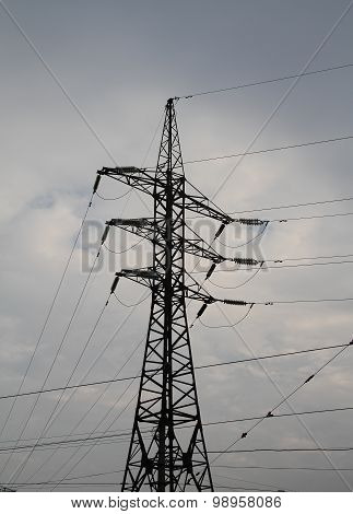 Silhouette of high voltage power line pylon