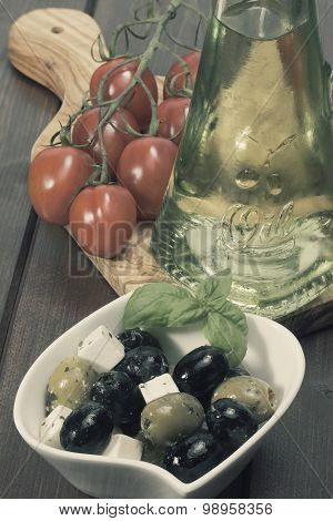 Vintage Photo Of Olive Salad, Tomatoes And Oil Bottle