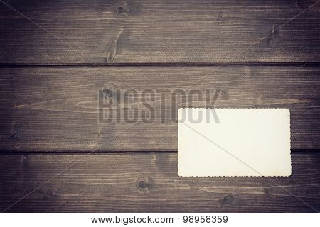 The Old Blank Photo Lying On A Wooden Desk