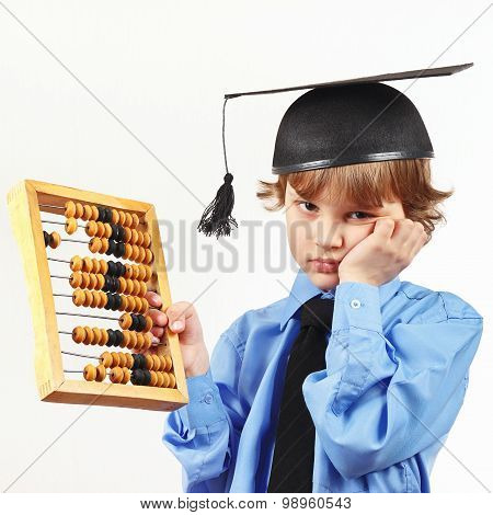 Tired boy in academic hat with old abacus on white background