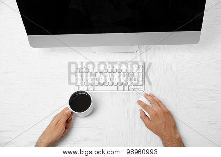 Man hand on computer keyboard on table top view
