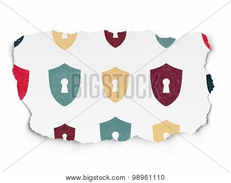 Safety concept: Shield With Keyhole icons on Torn Paper background