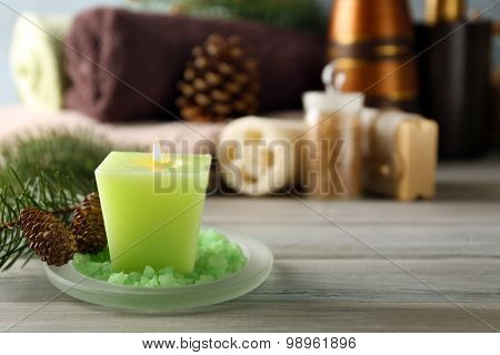 Spa treatments with pine essential oils on wooden background
