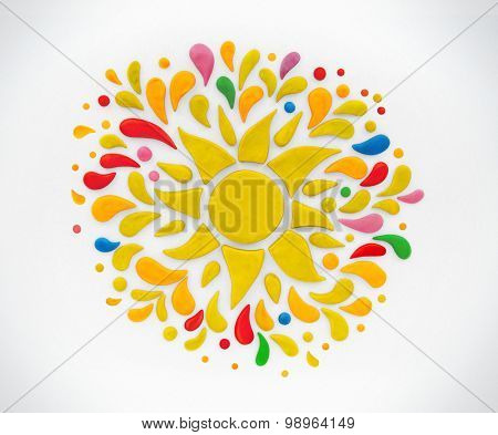 Decorative sun on a white background. Plasticine illustration