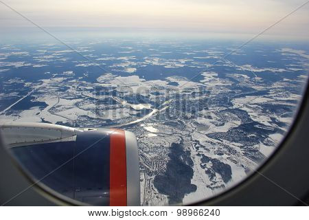 view from airplane over the city in winter