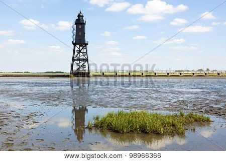 Obereversand Lighthouse at Dorum, view from the wadden sea