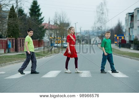 children crossing street on crosswalk