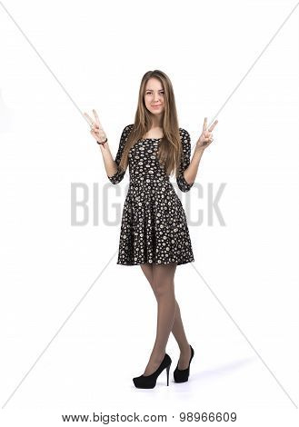 Young lady showing VICTORY sign with her hands