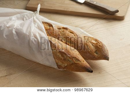 Traditional fresh french baguettes packed in paper
