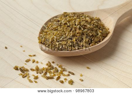 Wooden spoon with roasted Freekeh