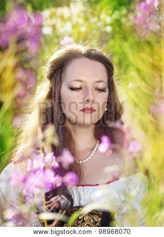 Beautiful Young Woman With Long Hair On Summer Meadow