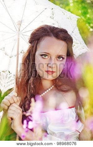 Beautiful Young Woman With Umbrella On Summer Meadow