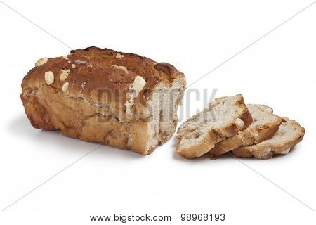 Traditional dutch sugar bread cut into slices on white background