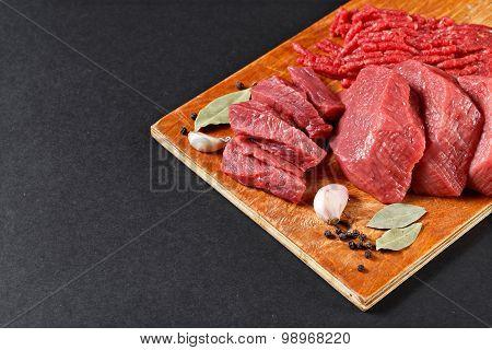 Fresh Butcher Cut Meat Assortment On Black Background