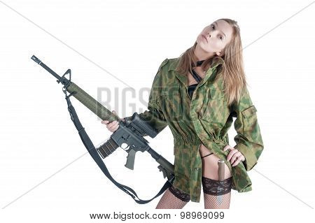 Pretty woman with gun and knife over white