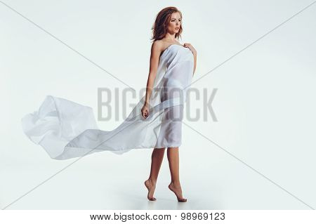 Naked Woman In Transparent Cloth Looking Away