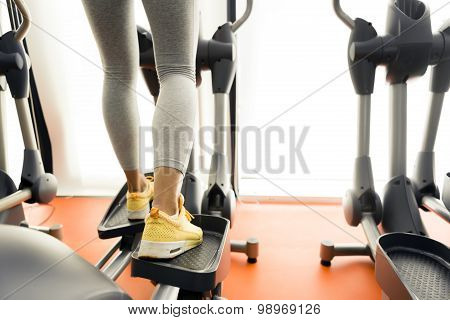 Closeup Of A Woman Using A Stepper And Training In A Gym