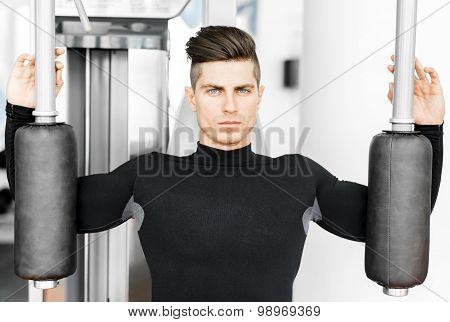 Portrait Of A Handsome Young Man Training In A Gym