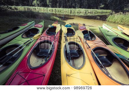 Colorful Kayaks Moored On Lakeshore