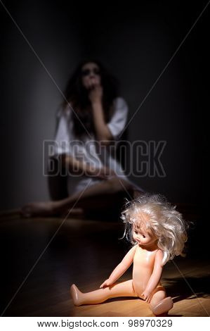 Crazy girl and plastic doll