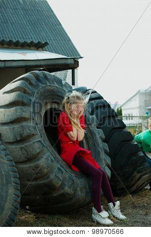 girl playing hide and seek in dump