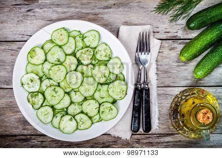 Green Salad With Fresh Organic Cucumbers And Dill With Olive Oil