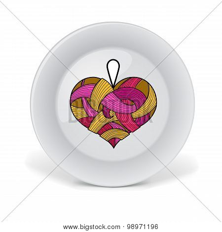 Decorative plate with colorful lace heart.