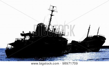 Shipwreck Of A Beached Diesel Tanker In Silhouette