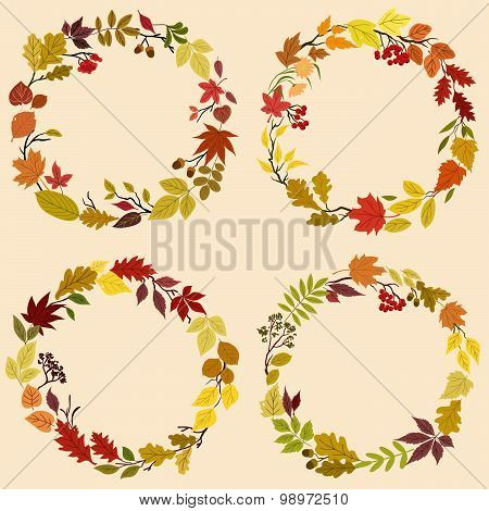 Wreaths of autumn leaves, flowers and herbs