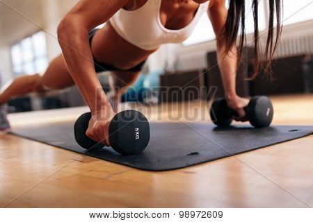 Woman Doing Pushups On Dumbbells
