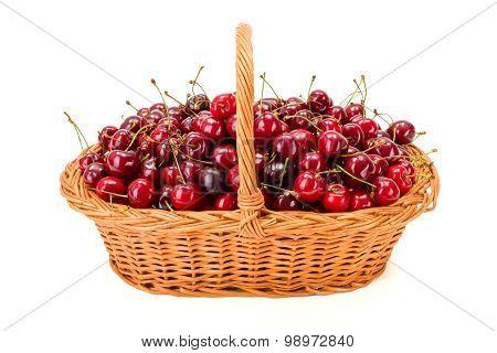 Sweet Cherries (prunus Avium) In Wicker Basket