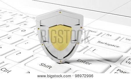 Silver shield symbol on laptop white keyboard