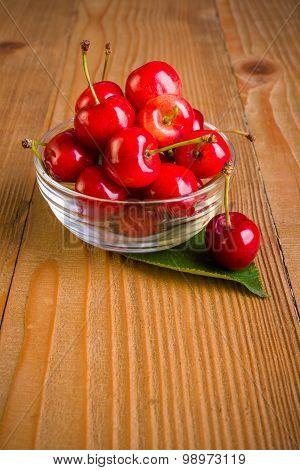 Sweet Cherries (prunus Avium) In Plate On Wooden Board