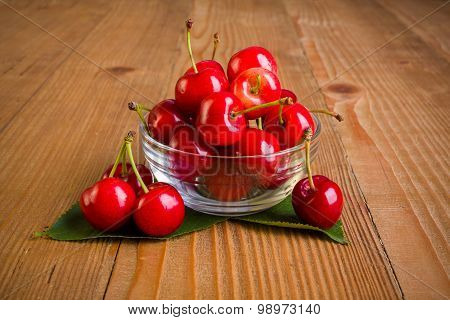 Sweet Cherries (prunus Avium) In Plate On Wooden Board
