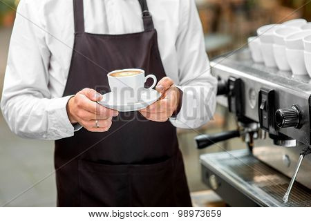 Holding coffee cup