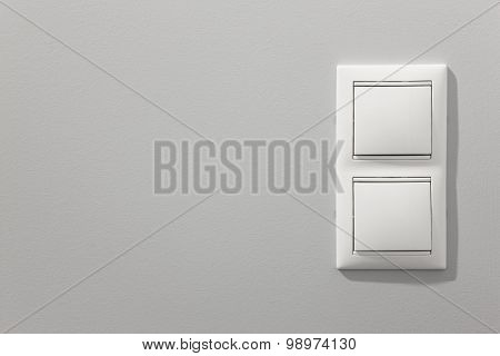 White Light Switches Over A Grey Wall